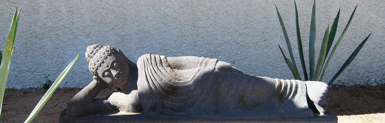 Gardens at Yoga Retreat Mexico: Reclining Buddha Statue in tthe Garden